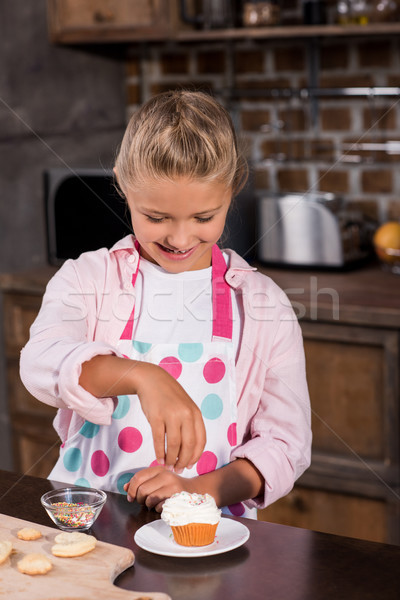 kid making cupcake Stock photo © LightFieldStudios
