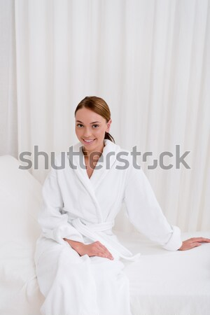 Stock photo: Smiling woman holding jar of cream