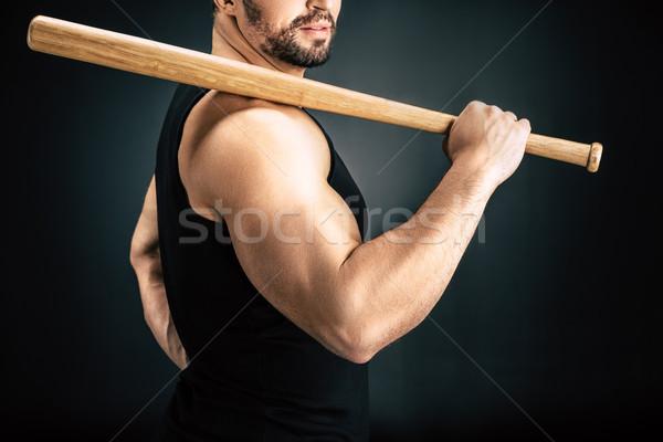 Hombre bate de béisbol vista aislado negro madera Foto stock © LightFieldStudios