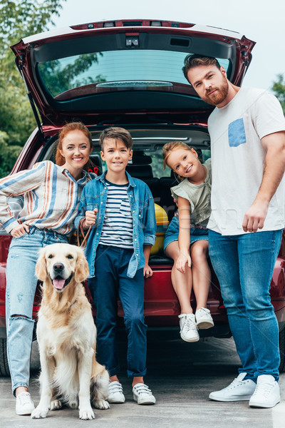 Stock photo: family with dog standing next to car