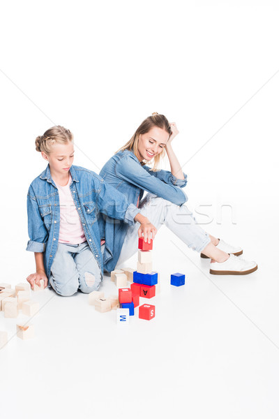 mother and daughter with aphabet blocks Stock photo © LightFieldStudios