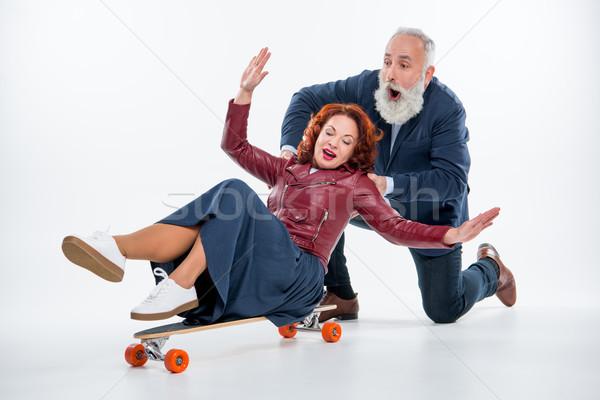 érett pár gördeszka izgatott szórakozás fehér Stock fotó © LightFieldStudios