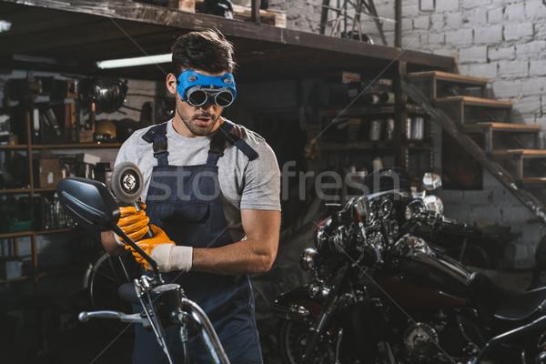 mechanic with circular saw Stock photo © LightFieldStudios