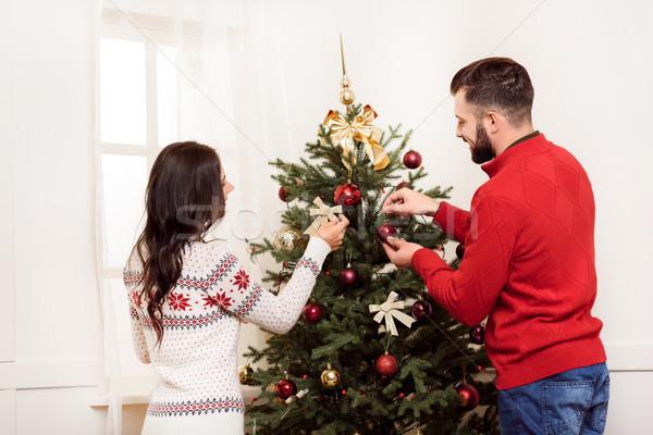 Pár karácsonyfa hátulnézet fiatal pér együtt otthon Stock fotó © LightFieldStudios