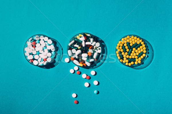 colorful pills in petri dishes Stock photo © LightFieldStudios