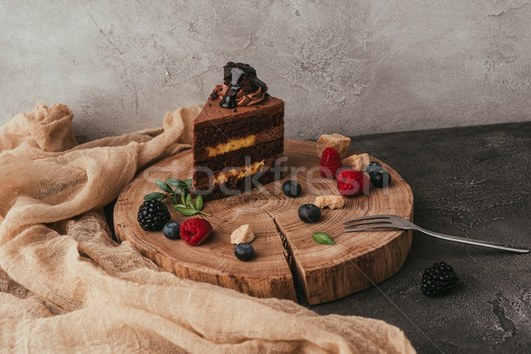 close-up view of sweet tasty chocolate cake with berries on wooden board  Stock photo © LightFieldStudios