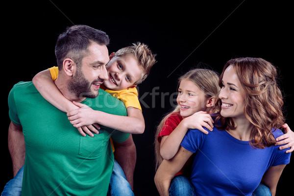 Famille heureuse coloré regarder autre noir Photo stock © LightFieldStudios