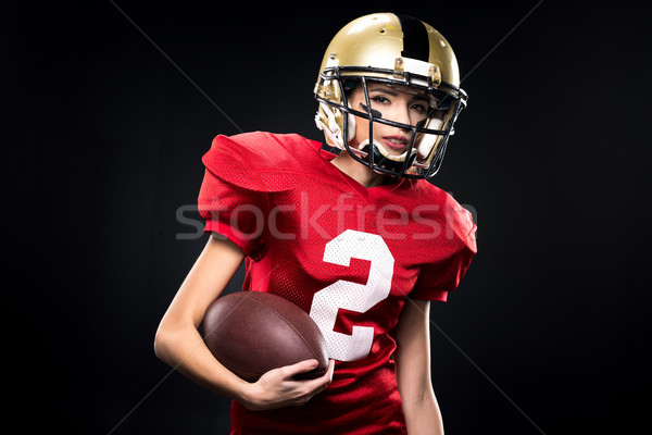 Female american football player in sportswear Stock photo © LightFieldStudios