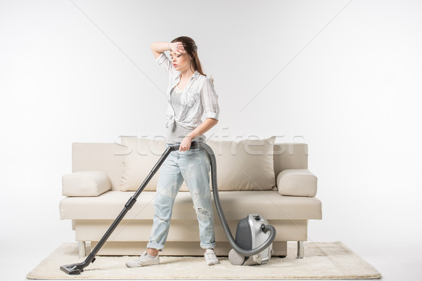 Woman vacuuming carpet Stock photo © LightFieldStudios
