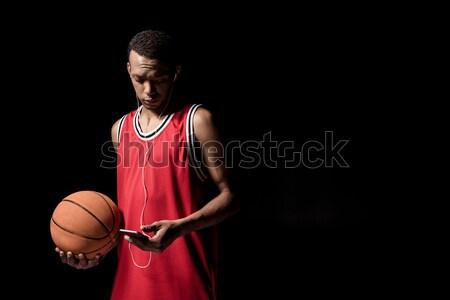Fiatal kosárlabda labda fülhallgató tart okostelefon Stock fotó © LightFieldStudios
