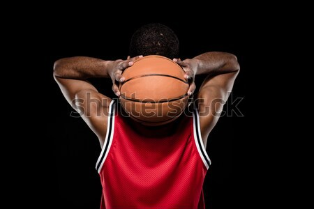Back view of african american basketball player throwing ball on black  Stock photo © LightFieldStudios