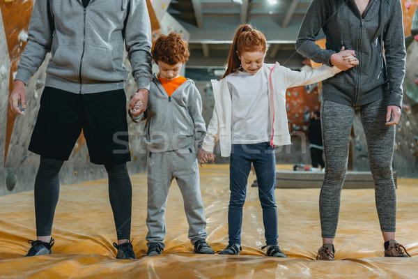 Famiglia holding hands palestra shot ragazzi piedi Foto d'archivio © LightFieldStudios