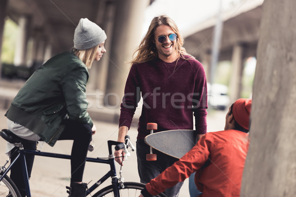 friends spending time together outdoors Stock photo © LightFieldStudios