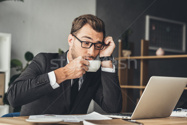 overworked businessman drinking coffee Stock photo © LightFieldStudios