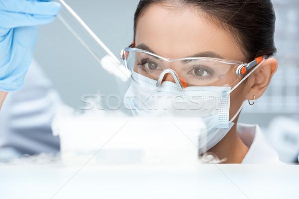 Fiatal nő tudós védőszemüveg maszk készít kísérlet Stock fotó © LightFieldStudios