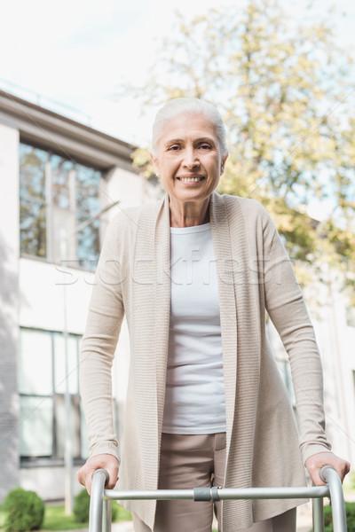 senior woman with walker Stock photo © LightFieldStudios