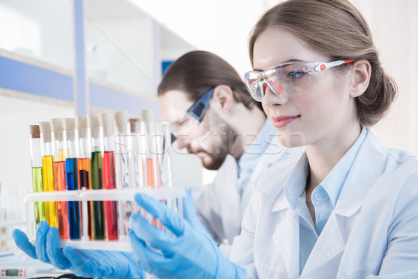 Scientist looking on test tubes   Stock photo © LightFieldStudios