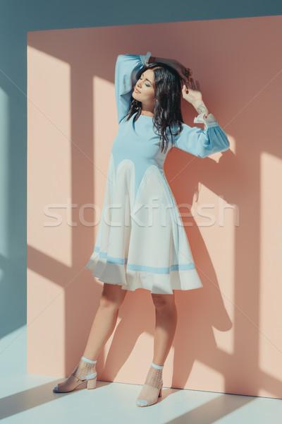 Nő türkiz ruha csukott szemmel gyönyörű nő divatos Stock fotó © LightFieldStudios