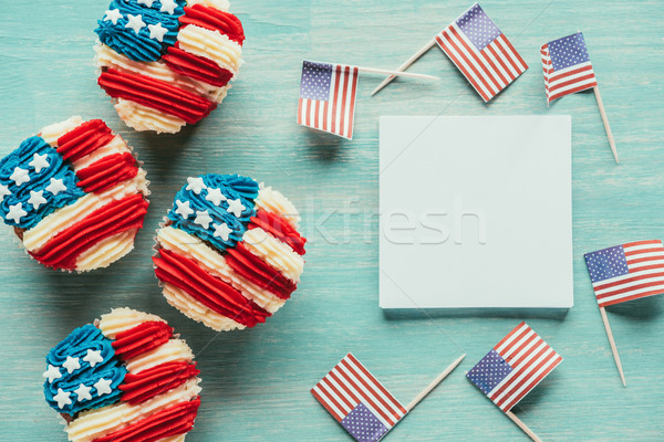 flat lay with arranged cupcakes and american flags on wooden tabletop, presidents day celebration co Stock photo © LightFieldStudios