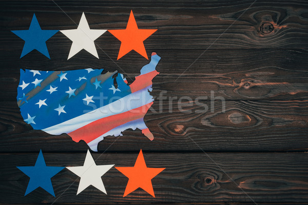 top view of arranged stars and piece of map with american flag on wooden tabletop, presidents day co Stock photo © LightFieldStudios