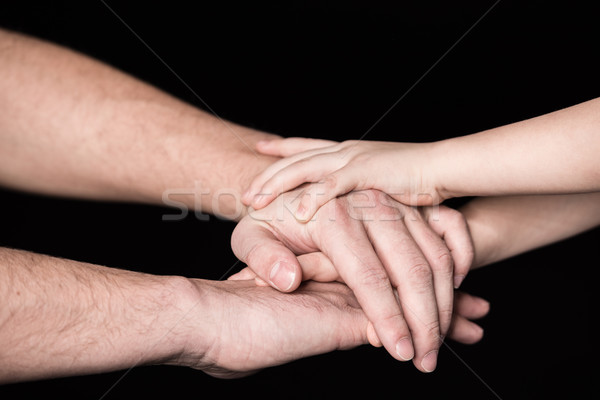 Father and child stacking hands Stock photo © LightFieldStudios