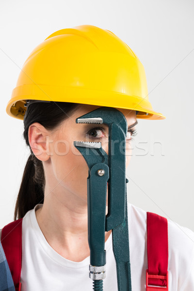 Female builder holding wrench Stock photo © LightFieldStudios