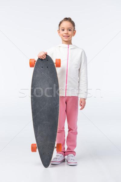 улыбаясь девушки Постоянный скейтборде белый ребенка Сток-фото © LightFieldStudios