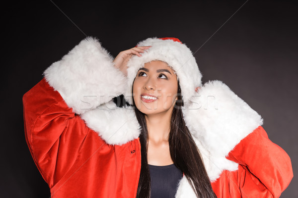 Woman in santa costume and swimsuit Stock photo © LightFieldStudios