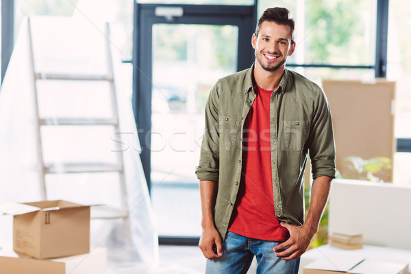 handsome man in new house Stock photo © LightFieldStudios