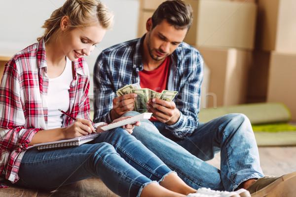 Geld vergadering vloer nieuwe appartement Stockfoto © LightFieldStudios