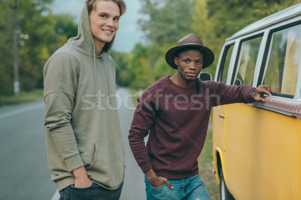 multiethnic men standing at minivan Stock photo © LightFieldStudios