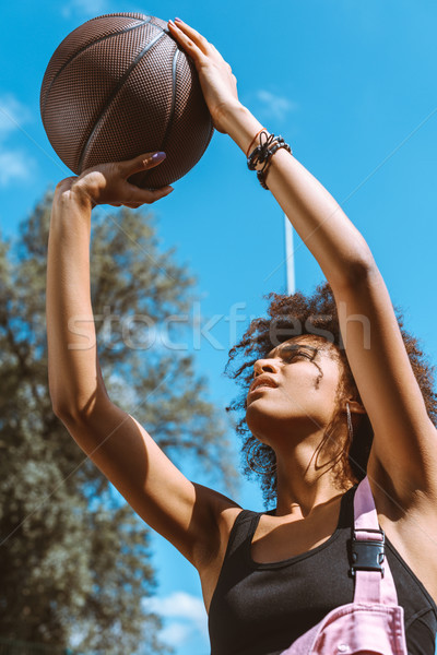 african-american woman throwing basketball Stock photo © LightFieldStudios