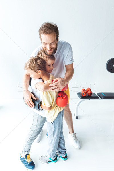 father hugging sons in boxing gloves Stock photo © LightFieldStudios