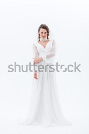 Vonzó menyasszony pózol hagyományos esküvői ruha izolált Stock fotó © LightFieldStudios