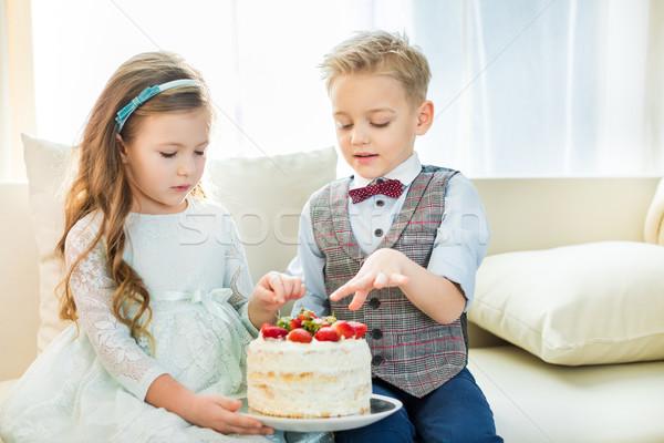Siblings holding cake Stock photo © LightFieldStudios