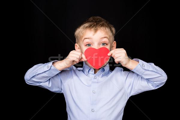 Boy with paper heart Stock photo © LightFieldStudios