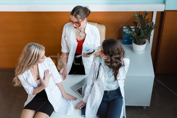 high angle view of three doctors having conversation at workplace Stock photo © LightFieldStudios