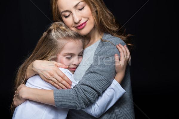 Anya lánygyermek átkarol boldog fiatal aranyos Stock fotó © LightFieldStudios