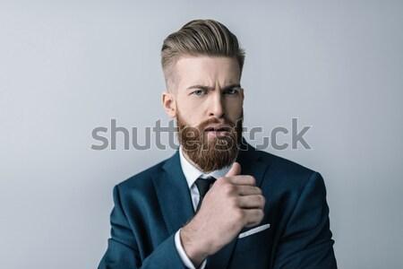 бородатый бизнесмен глядя камеры человека Сток-фото © LightFieldStudios