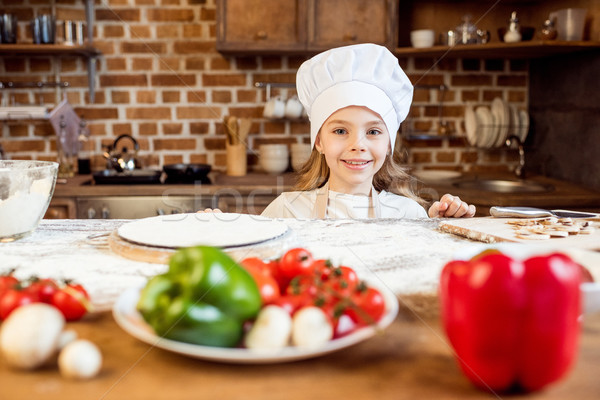 portrait of little girl with pizza dough and various ingredients  Stock photo © LightFieldStudios