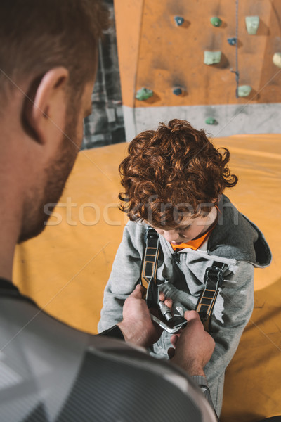Dad securing son in harness Stock photo © LightFieldStudios