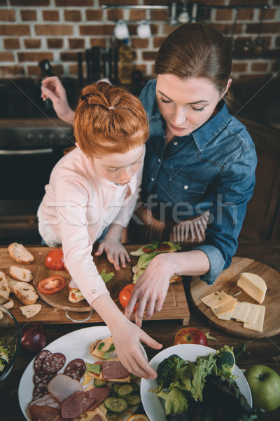 daughter and mother making salad Stock photo © LightFieldStudios