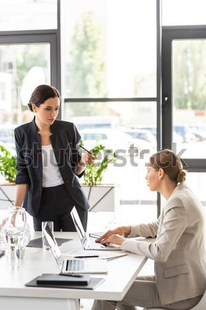 Seductive secretery leaning over desk Stock photo © LightFieldStudios
