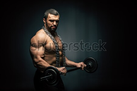 athletic man weightlifting Stock photo © LightFieldStudios