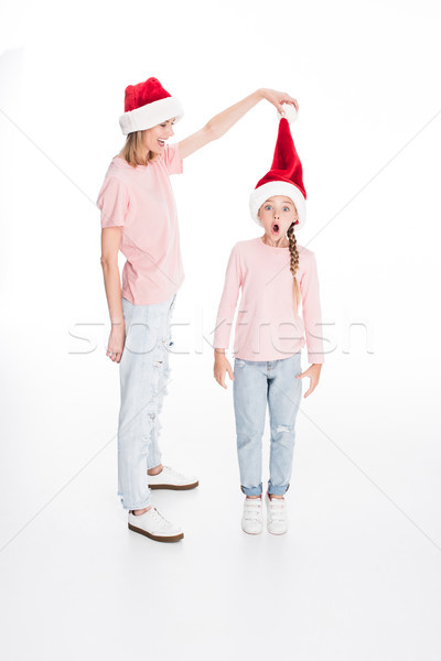 Stock photo: mother and daughter in santa hats