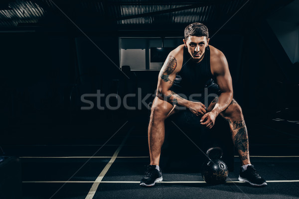 Athletic sportsman in gym Stock photo © LightFieldStudios