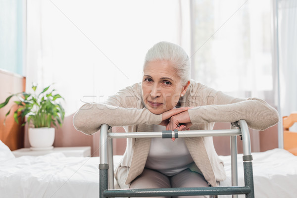 senior woman with walker in hospital Stock photo © LightFieldStudios