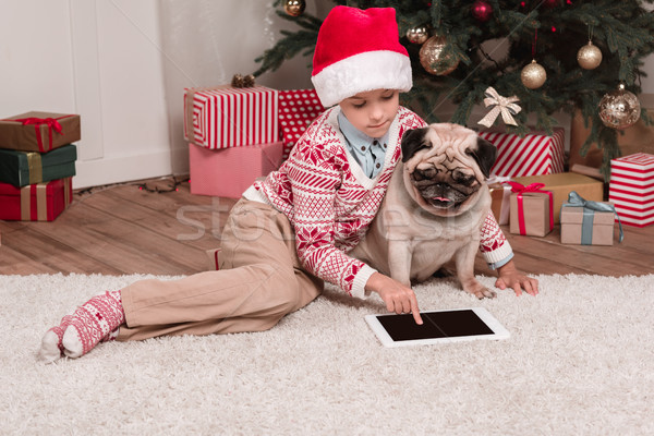 boy with pug using tablet on christmas Stock photo © LightFieldStudios