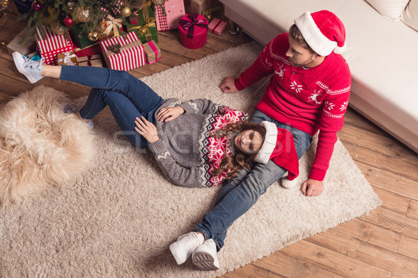 young couple in santa hats Stock photo © LightFieldStudios