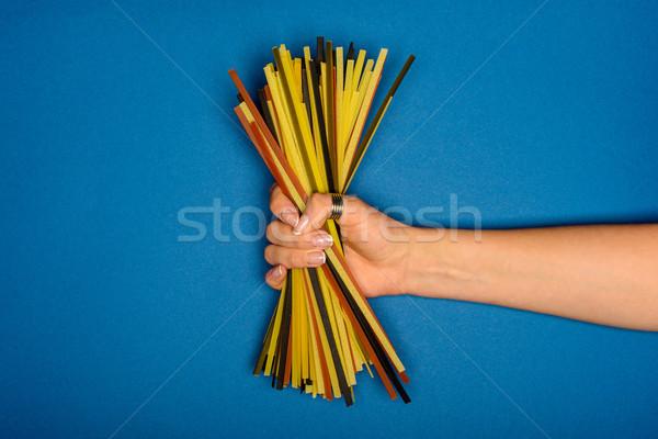 женщину сырой спагетти выстрел синий Сток-фото © LightFieldStudios